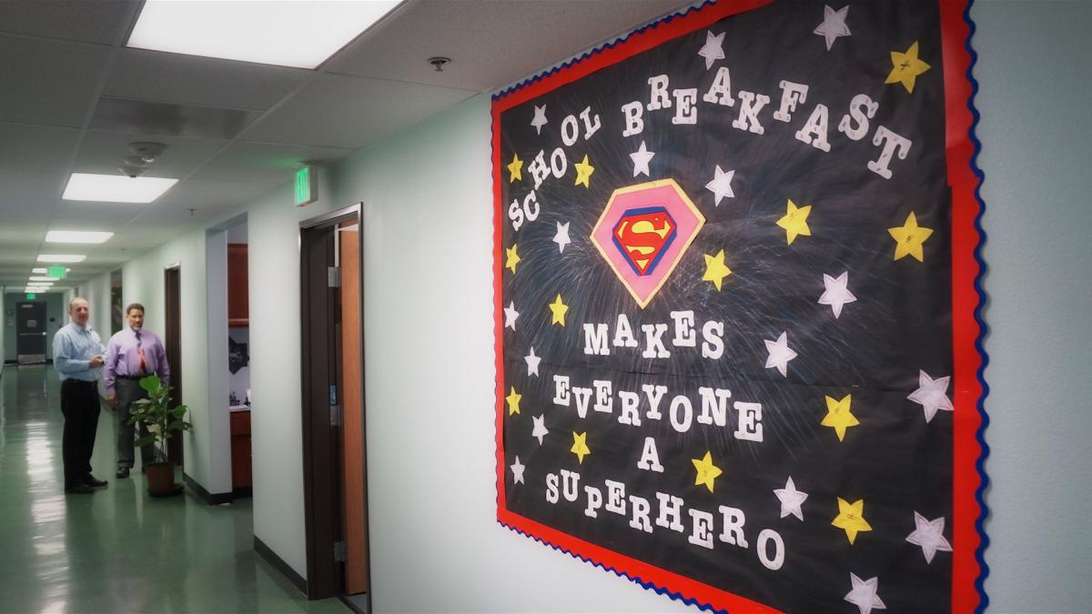 "Photo of a poster made by Ballington Academy about the charter school free lunch program and breakfast program that says ""School Breakfast Makes Everyone a Hero""."